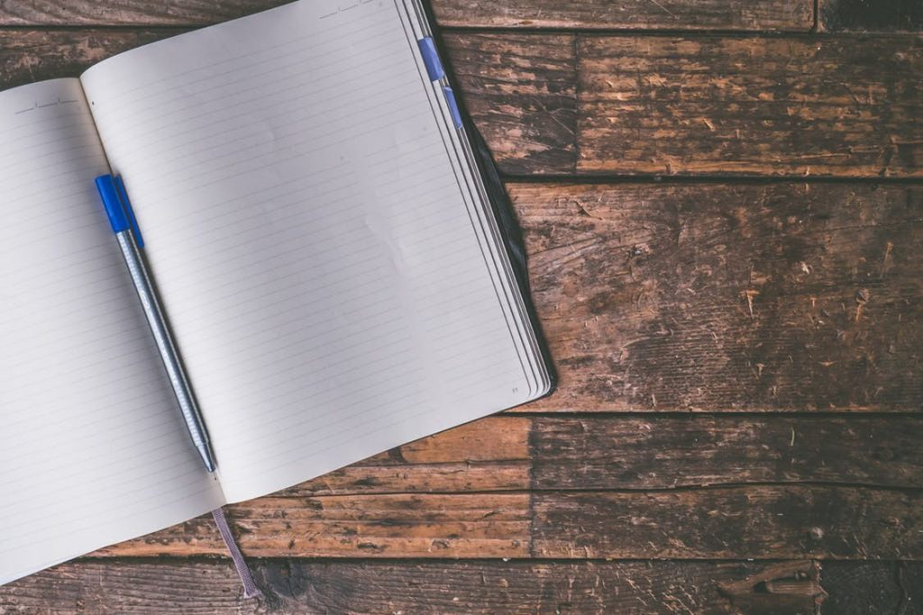 a pen on the notebook joy and pain of writing